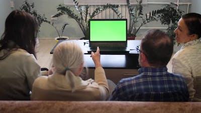 Family Watching Laptop. Green Screen.