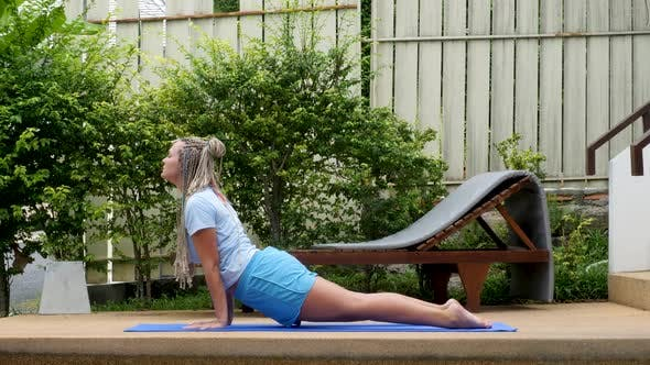 Young Woman Does Yoga