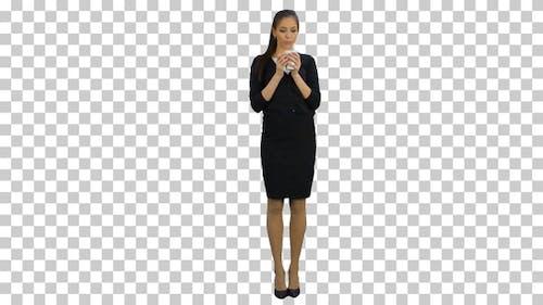 Happy secretary enjoying cup of coffee, Alpha Channel