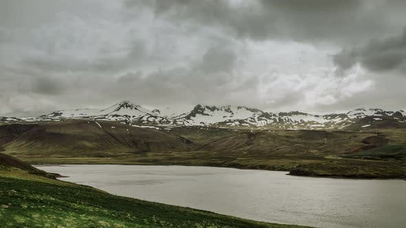 Cover Image for Rolling Clouds Over Nothern Snow Mountains With Glacer And Arctic Sea Harbour In Iceland
