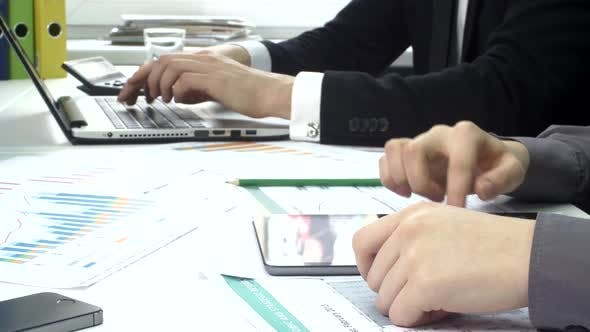 Thumbnail for Business Peoples Working in the Office with Laptop and Tablet