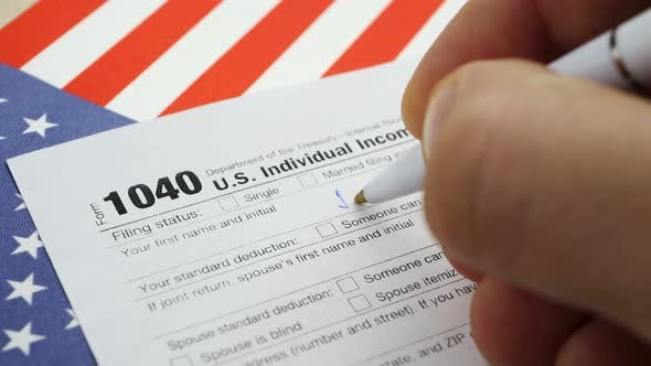 Thumbnail for Hand Filling American 1040 Individual Income Tax Return Form