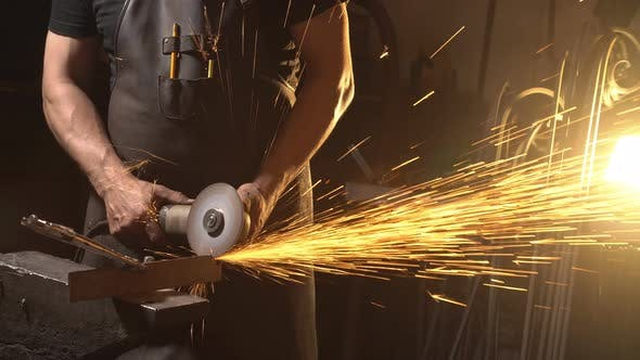 Thumbnail for Sparks During Cutting of Metal Angle Grinder. Worker Using Industrial Grinder