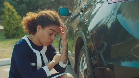 Thumbnail for Upset Black Woman Checking Car Scratches Outdoors
