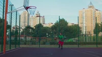 Athlete Doing Reverse Layup on Basketball Court