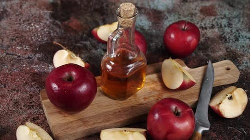 Apple Cider Vinegar on a Wooden Table.