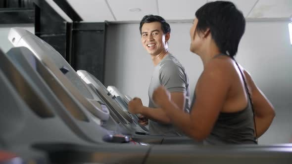 Thumbnail for Asian Man and Woman Exercising in Gym
