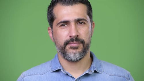 Handsome Persian Bearded Man Against Green Background