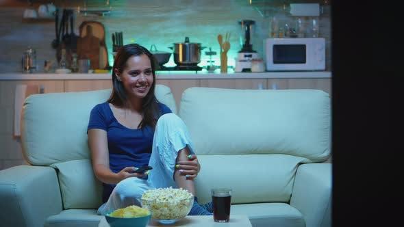 Thumbnail for Woman Eating Popcorn on Sofa