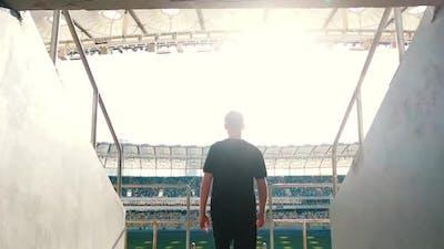 Guy Goes To the Podium of the Stadium