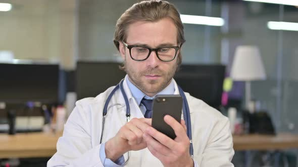 Thumbnail for Portrait of Doctor Using Smartphone for Internet