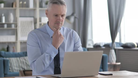 Thumbnail for Pensive Gray Hair Businessman Thinking and Working on Laptop
