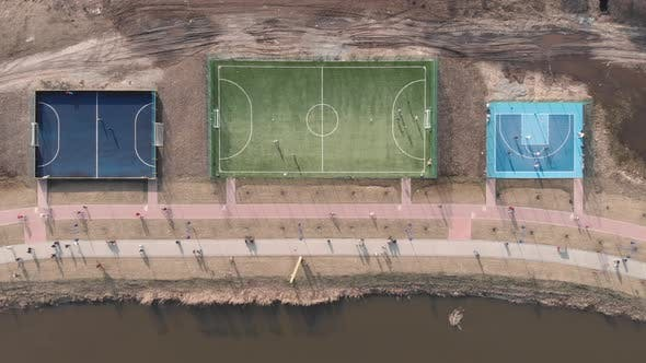 Soccer, football and basketball fields on sport playground in modern city district