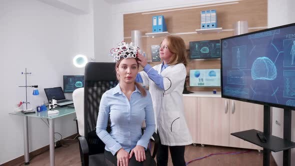 Thumbnail for Female Scientist in a Neuroscience Facilty with a Patient