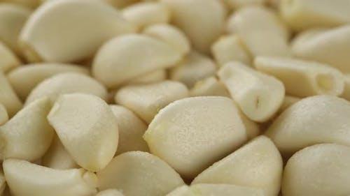 Peeled garlic close up rotating