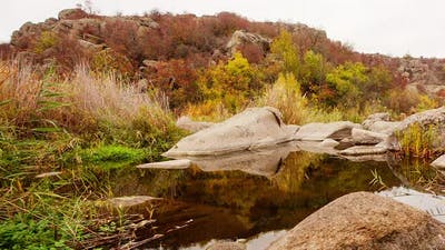 Autumn Trees and Large Stone Boulders Around
