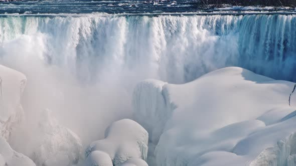 Thumbnail for The Flow of Water Falls on Blocks of Ice and Snow