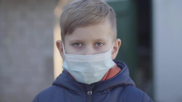 Thumbnail for Portrait of Caucasian Little Boy Taking Off Face Mask at the End of Covid-19 Quarantine. Happy
