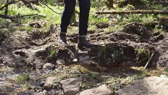 Thumbnail for Young Man Crossing Brook in Forest