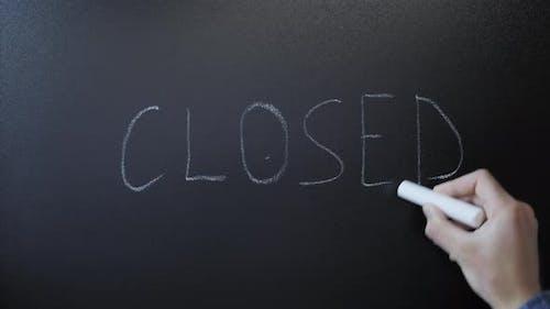 """""""Closed"""" written on chalkboard"""