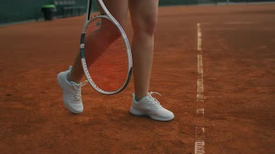 Woman Playing Tennis Fulfills Supply. Professionally Trains Tennis. Young Pretty Girl Plays Tennis