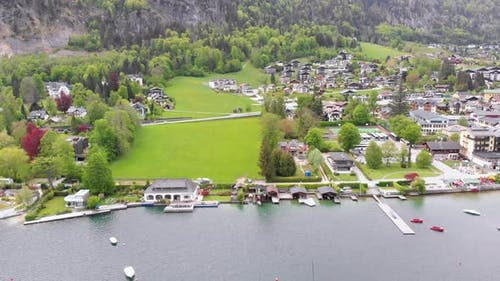 Aerial View of Mountain Lake Wolfgangsee with Houses of Resort Town in Austria, Alps