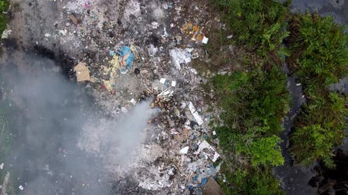 Air pollution due to open burn garbage