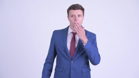 Cover Image for Happy Young Handsome Businessman Blowing Kiss