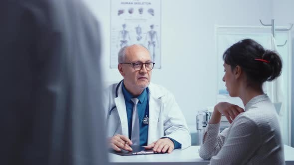 Thumbnail for Doctor Talking with Young Female Patient