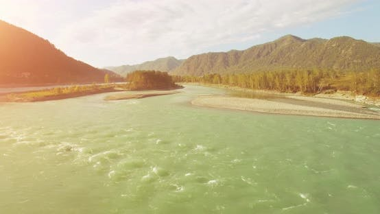 Thumbnail for UHD Aerial View. Low Flight Over Fresh Cold Mountain River at Sunny Summer Morning. Green Trees and