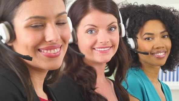 Thumbnail for Three customer service representatives smiling