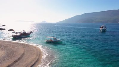 Boats with Tourists on Sea Bay