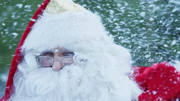 Close up of Santa Claus facing the snowfall