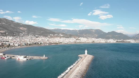 Beautiful city landscape of Alanya with harbor, residential buildings, coastline and mountains