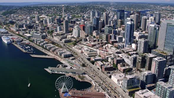 Thumbnail for Helicopter Flight Over Seattle Waterfront Piers And Tall Buildings