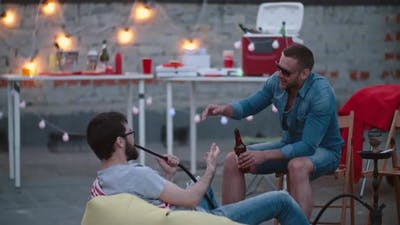 Male Friends Chilling on Rooftop