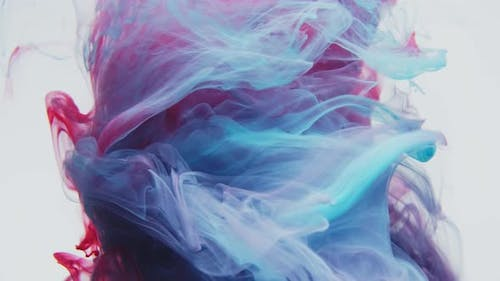 A Beautiful Mixture of Acrylic Ink in Water. White Backgroun