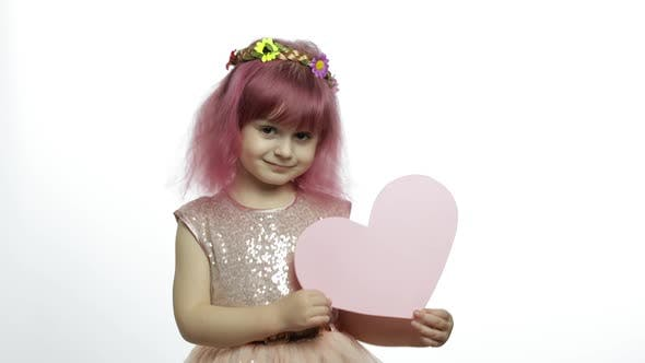 Thumbnail for Child Girl Princess Holds Pink Paper Heart. Mothers Day, Valentines Day Concept
