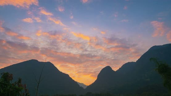 Cover Image for Time lapse sunset colorful sky clouds dramatic mountain landscape valley Laos