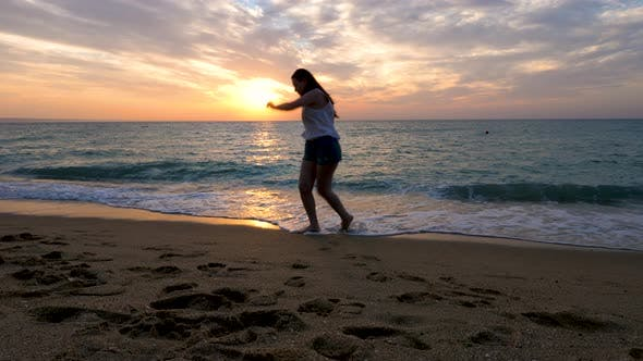 Thumbnail for Happy Woman Playing and Running From the Water on the Beach