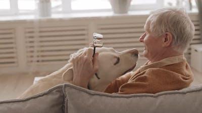 Cheerful Senior Man with Cute Labrador Retriever