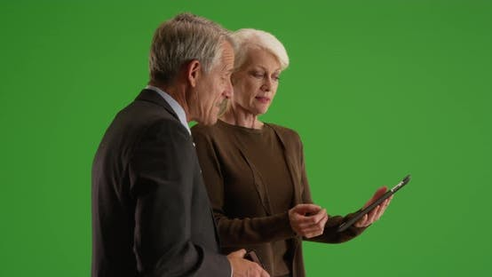 Thumbnail for Senior business team working in the office with tablet on green screen