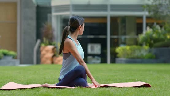 Thumbnail for Woman do yoga at the park