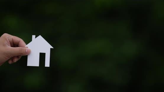 Hand give paper house shape