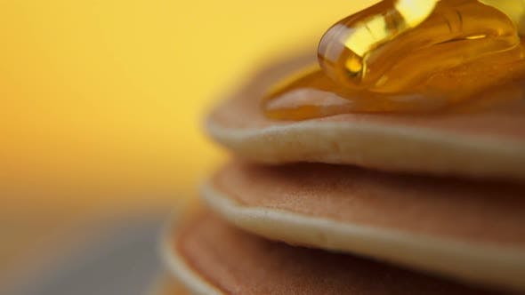 Thumbnail for Pouring Honey on Stack of Pancakes. Slow Motion.