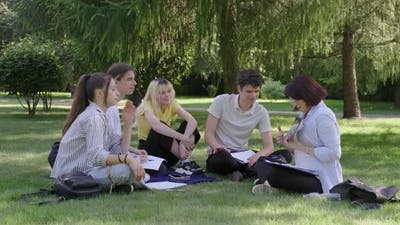 Outdoor Group of Students with Female Teacher