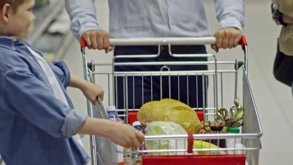 Thumbnail for Young Family Walking in Grocery Store