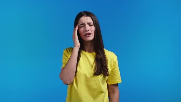 Portrait of Woman Having Headache Blue Studio Portrait