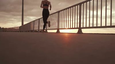 Girl Running on the Background of the Sunset