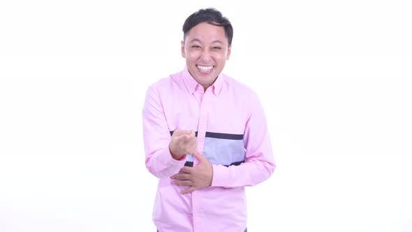 Thumbnail for Happy Japanese Businessman Laughing and Pointing at Camera